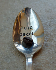 Coffee bean in a spoon